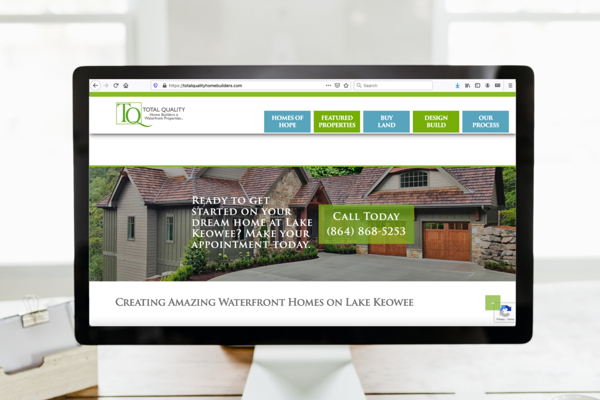 Desktop computer with Total Quality Homebuilders website on the screen