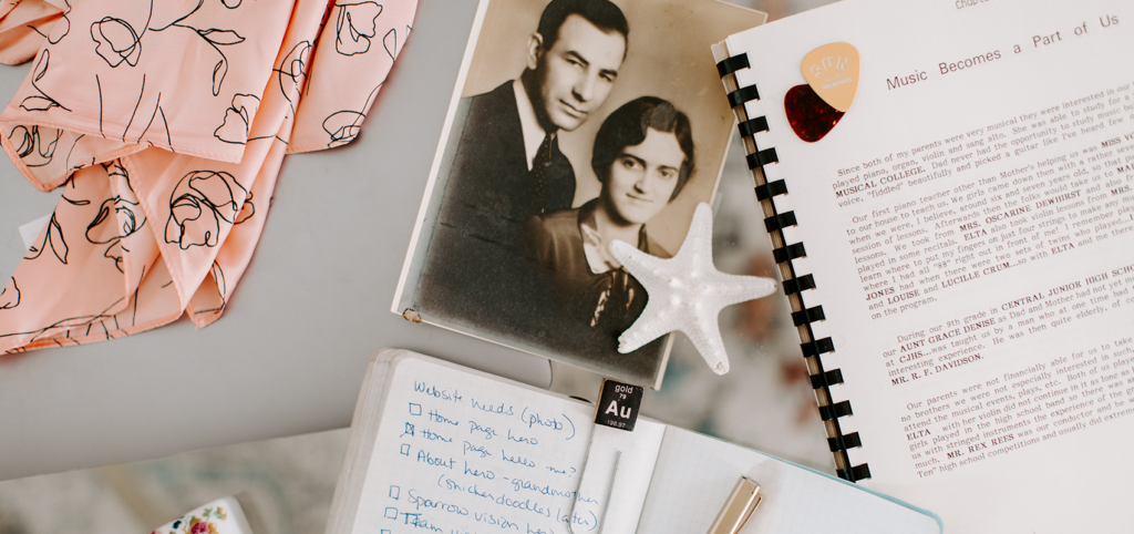 Desktop images including a notebook, a book written by Melody's grandmother, a photo of her grandparents, a starfish, a laptop, and a pink scarf