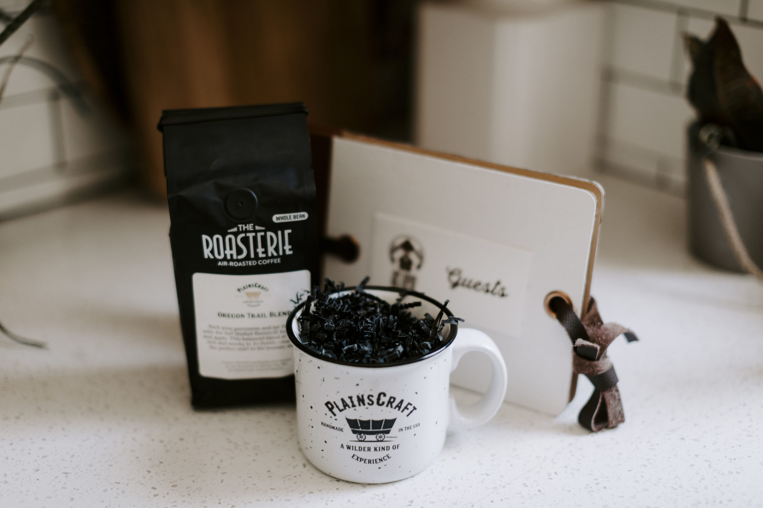 PlainsCraft customer gifts, including coffee, a camping mug, and a guest book
